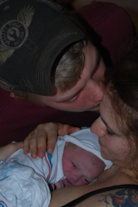 Jacob gives his wife a tender kiss after the birth of daughter Delilah